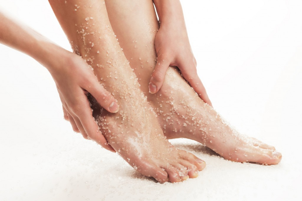 Woman Exfoliating Feet with Salt
